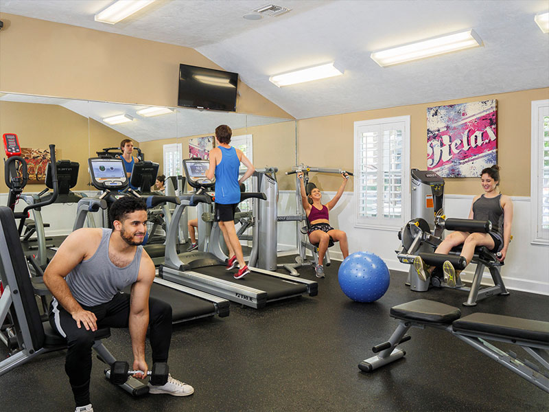 Residents exercising in the fitness center