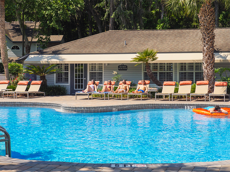 View of the pool with lounge chairs on the other side