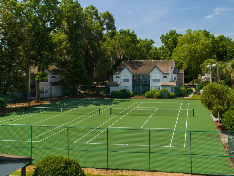 Large tennis court with two nets